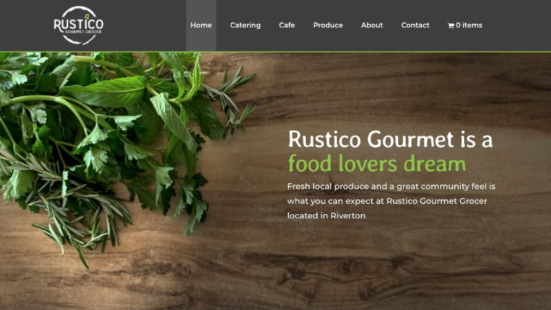 The Rustico Gourmet home page with herbs on a wooden board as the image at the top of the page.